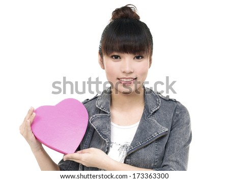 Close up Girl with big heart red gift box