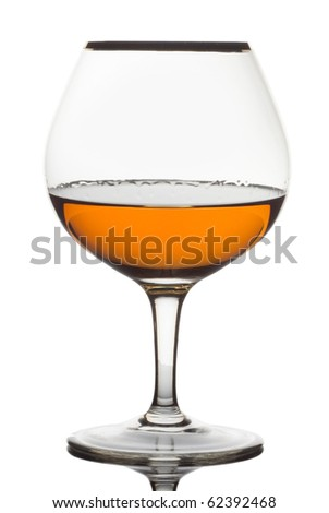 Close up glass of brandy on a white background - stock photo
