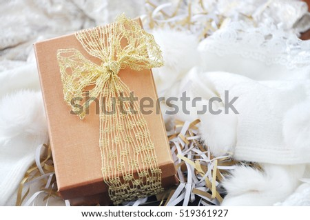 Close up golden ribbon gift box on white background