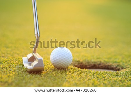 Close up golf ball on lip of cup  in course - stock photo