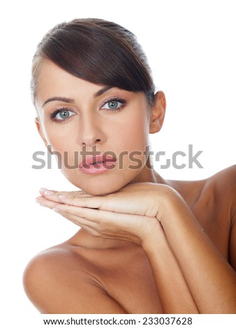 Close up Gorgeous Bare Woman Putting Tattooed Hands on the Chin While looking at the Camera. Isolated on White Background. - stock photo