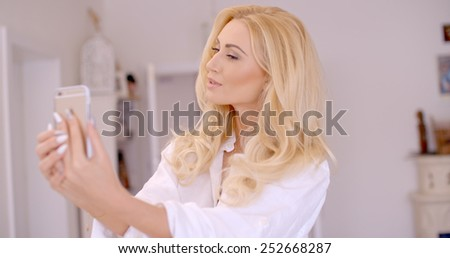 Close up Gorgeous Young Blond Woman Taking Selfie Photo While at the House.