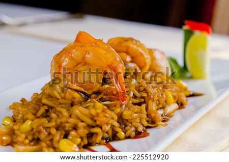 Close up Gourmet Appetizing Shrimps on Flavored Rice, Served on White Plate. - stock photo
