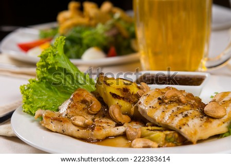 Close up Gourmet Juicy Chicken Meat Main Dish with Hot Dip Sauce and Fresh Lettuce on Dining Table. - stock photo