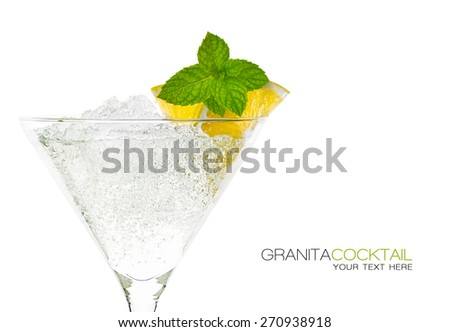 Close up granita cocktail garnished with lemon and mint in martini glass with ice conceptual of a tropical vacation, nightclub or celebration over white background. Template design with sample text - stock photo