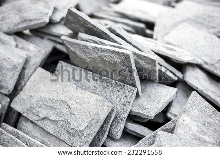 Close up gray stone tiles on stack. - stock photo