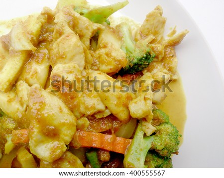 Close up green curry fried Vegetable with chicken on dish, Delicious fried fried vegetable with chicken green curry, Thai Food