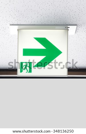 Close - up Green emergency exit sign  - stock photo