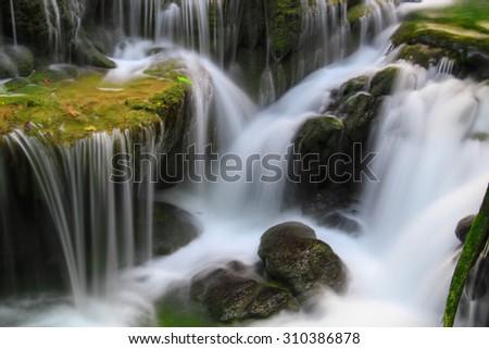 Close up green forest waterfall Huay Mae Kamin National Park Kanjanaburi Thailand - stock photo