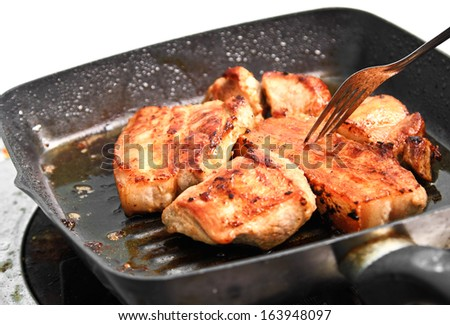 Close up grilled pork on frying pan.