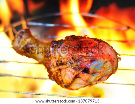 Close up grilling chicken on fire
