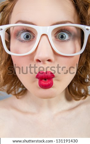 Close-up grimace of a funny woman with closed mouth - stock photo