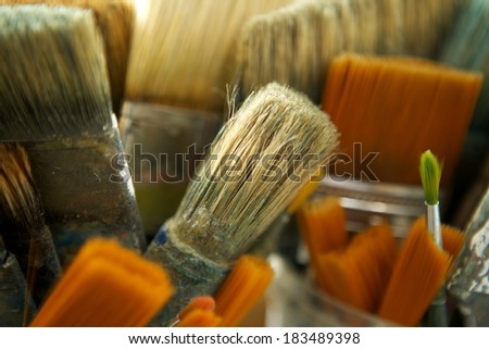 Close up group of various old used paintbrushes  - stock photo