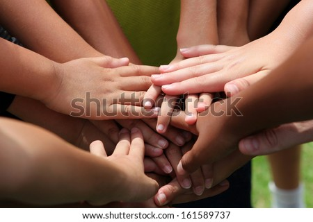 Close up group of young people's hands