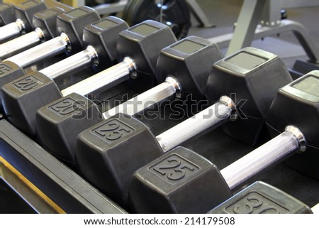 close up Gym Equipment barbells laying of a rack - stock photo