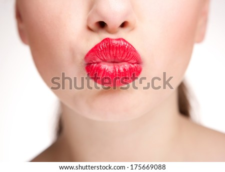 Close up half face of beautiful woman kissing with sexy red lips - stock photo