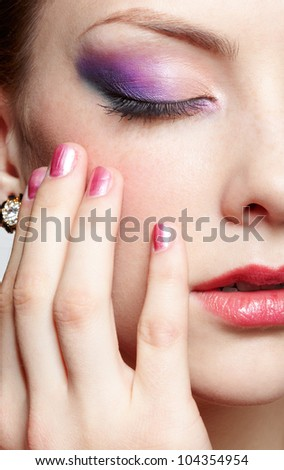 close-up half-face portrait of young beautiful woman with eyes closing eyes and touching face with manicured hand - stock photo