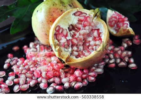 Close up half of pomegranate on black background
