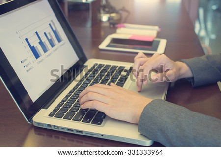 close up hand businesswoman working on computer laptop in vintage tone
