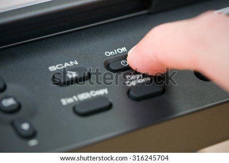 Close-up hand button open the photocopier.