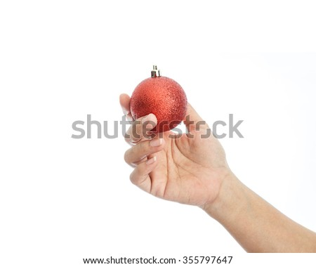 Close up hand holding Christmas ball isolated on white background