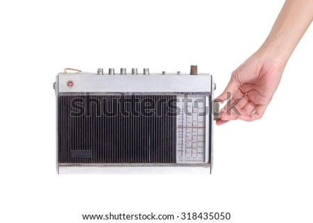 Close-up hand holding old retro radio, isolated on white background