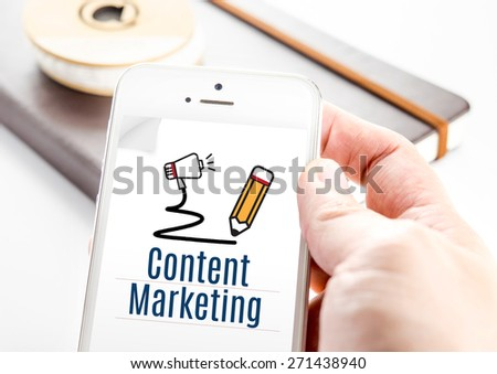 Close up hand holding smartphone with Content marketing word and pencil and speaker icon, Digital Marketing concept - stock photo