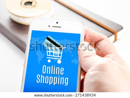 Close up hand holding smartphone with Online shopping word and credit card in cart icons, Business Marketing concept - stock photo