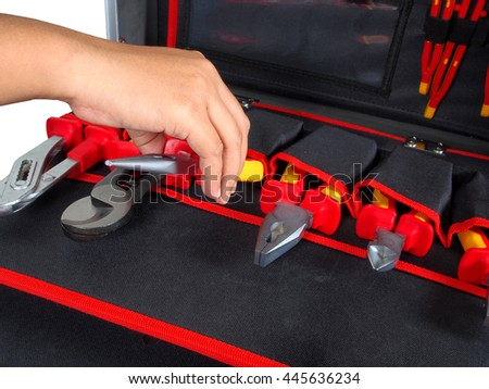 Close up, Hand man pick pliers for Toolbox - stock photo