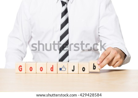 Close up Hand of a Businessman Arranging Wooden Blocks with good job words and like icon on blocks