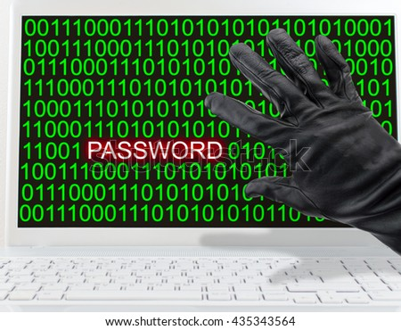 close up hand of a male thief stealing data from laptop computer - stock photo