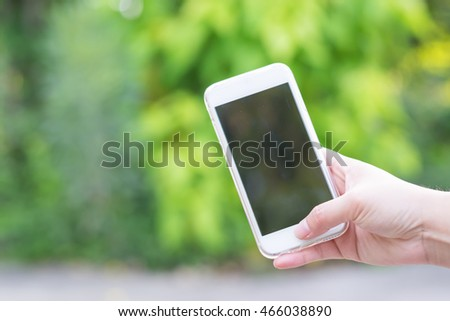 Close-up hand of asian woman using smart phone