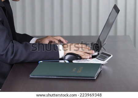 Close up hand of business man using the laptop computer  - stock photo