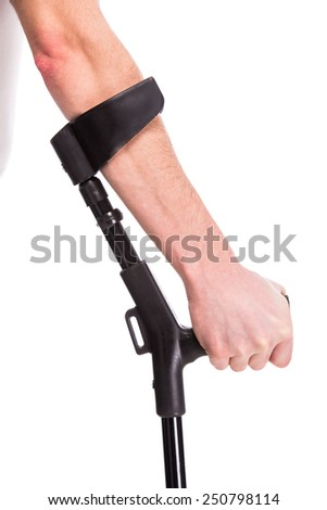 Close-up hand of man is using crutch on white background. - stock photo