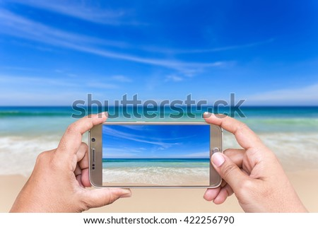 Close up hand of woman holding smartphone and take photo of view - stock photo