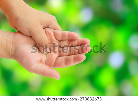Close up hand pain with blurred abstract green bokeh background
