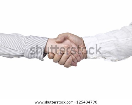 Close-up hand shake of two businesspeople against the white surface - stock photo