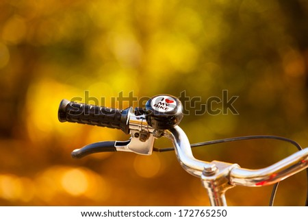 Close up handlebar with a bell, with the text I Love my bike. - stock photo