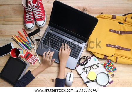 Close up hands holding big smart phone while connecting to wireless, businessman using technology sitting at modern loft wooden desk, people and modern devices everywhere - stock photo