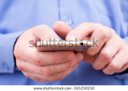 Close-up hands of  businessman using a smartphone - stock photo