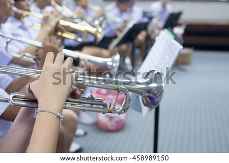 Close up hands of trumpet player on music band - stock photo