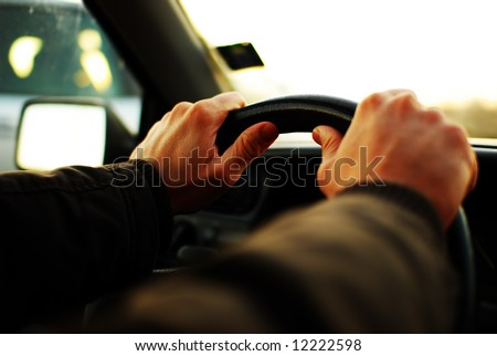 Close up : hands on steering wheel - stock photo