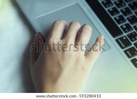Close up hands using laptop