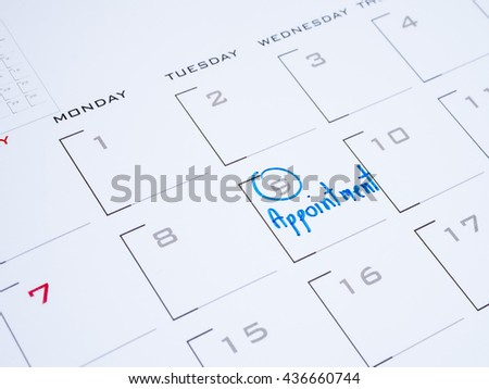 Close up handwriting word appointment on calendar desk (Selective focus) - stock photo