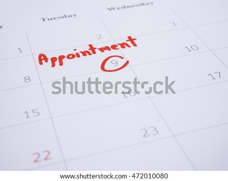 Close up handwriting word appointment on calendar desk (Selective focus)
