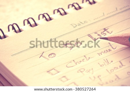 close up Handwritten to do list plan in a  small note book - stock photo