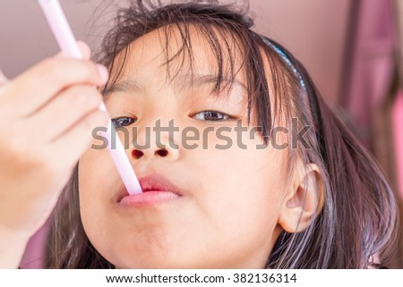 Close up happy adorable asian children biting water tube. - stock photo