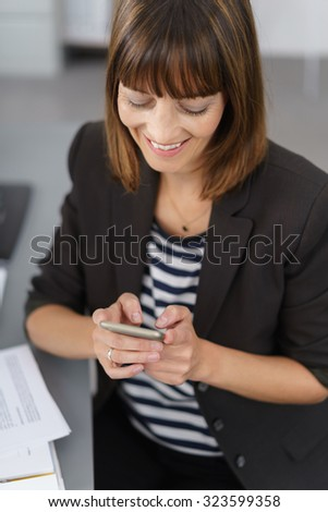 Close up Happy Businesswoman Busy with her Mobile Phone Inside the Office. - stock photo