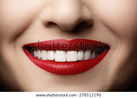 Close-up happy female smile with healthy white teeth, bright magenta lips make-up. Cosmetology, dentistry and beauty care. Macro of woman's smiling mouth. Beautiful smile - stock photo