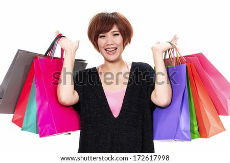 close up happy girl with shopping colorful bag - stock photo